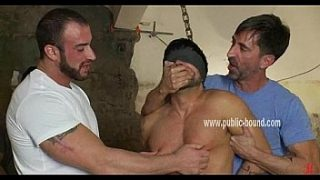 Man with big muscles is bent over
